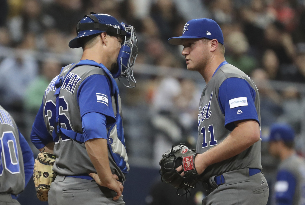 Israel pitcher Gabe Cramer, right, talks with catcher Ryan Lavarnway against South Korea during the sixth inning of the first round gam...