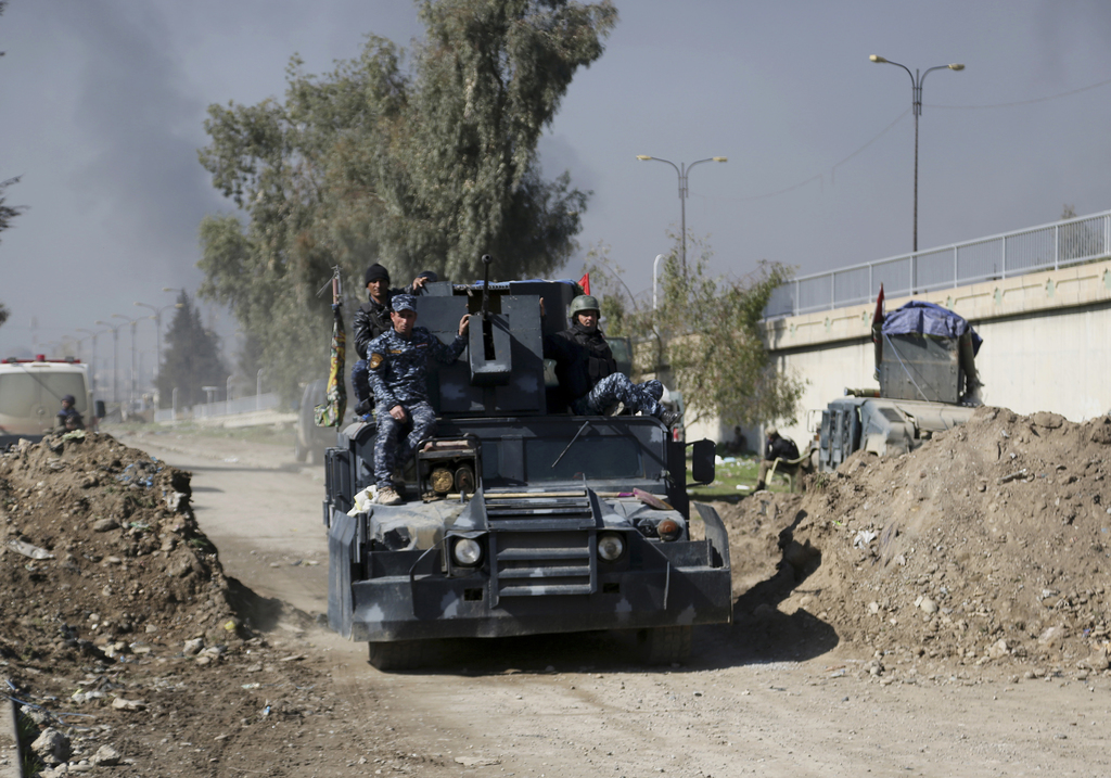 Iraqi security forces advance during fighting against Islamic State militants, in western Mosul, Iraq, Monday, March 6, 2017. (AP Photo...