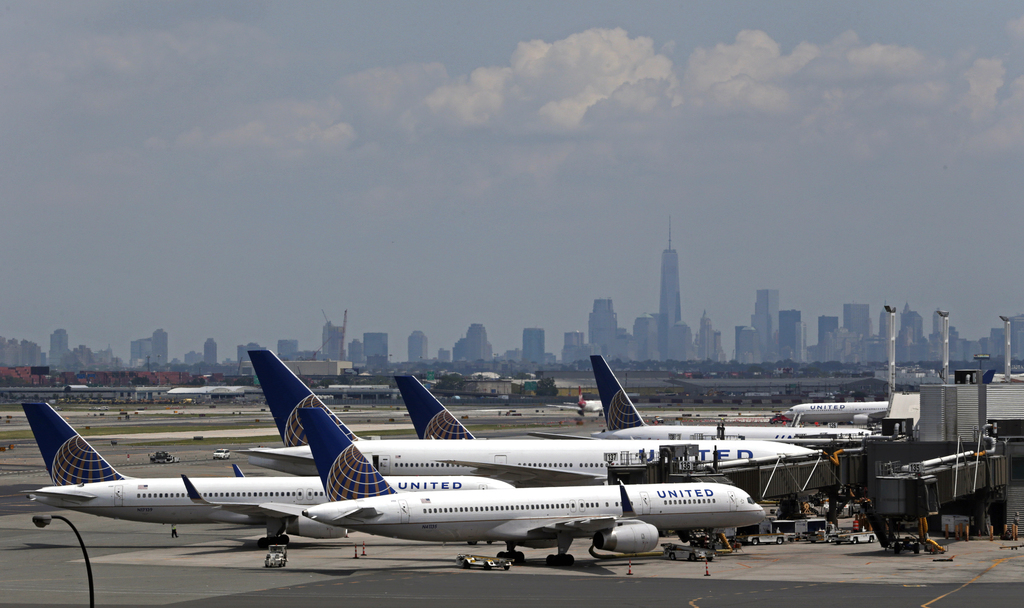 FILE – In this July 22, 2014, file photo, United Airlines jets wait at gates at Newark Liberty International Airport in Newark, N.J. Da...