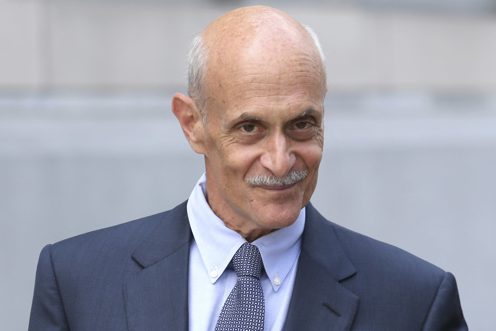 FILE – In this July 14, 2016, file photo, attorney and former U.S. Homeland Security Secretary Michael Chertoff leaves federal court af...