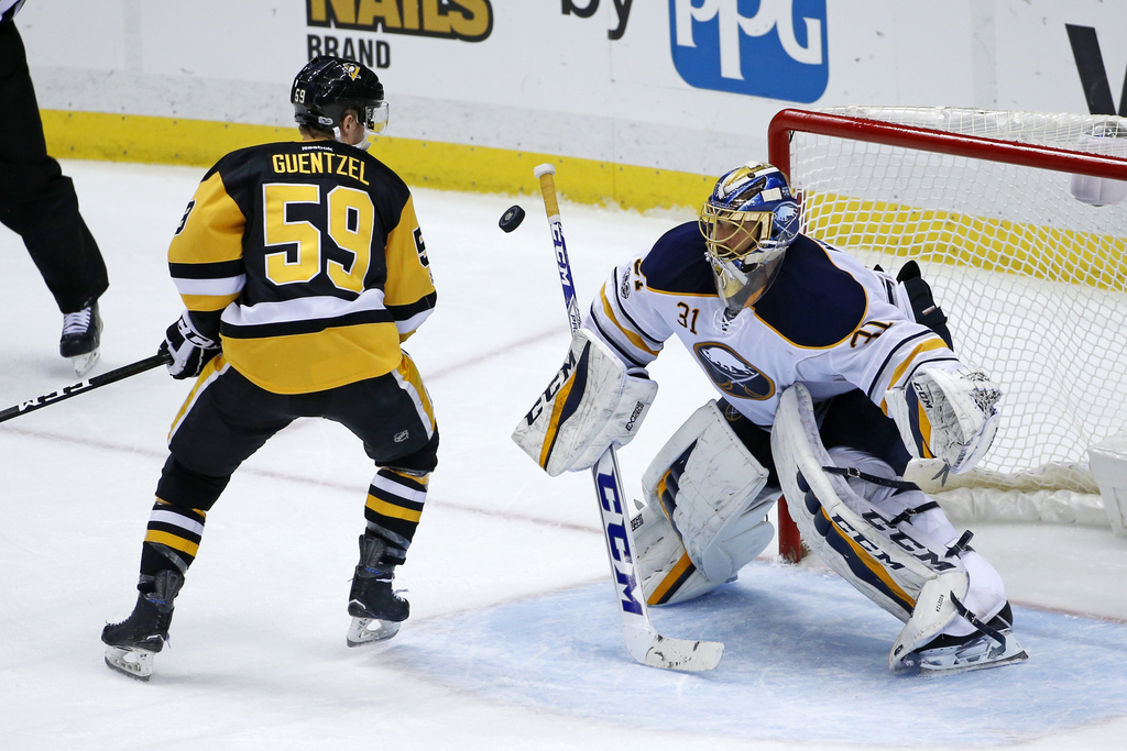 Pittsburgh Penguins' Jake Guentzel (59) deflects the puck past Buffalo Sabres goalie Anders Nilsson (31) for a goal in the third period...