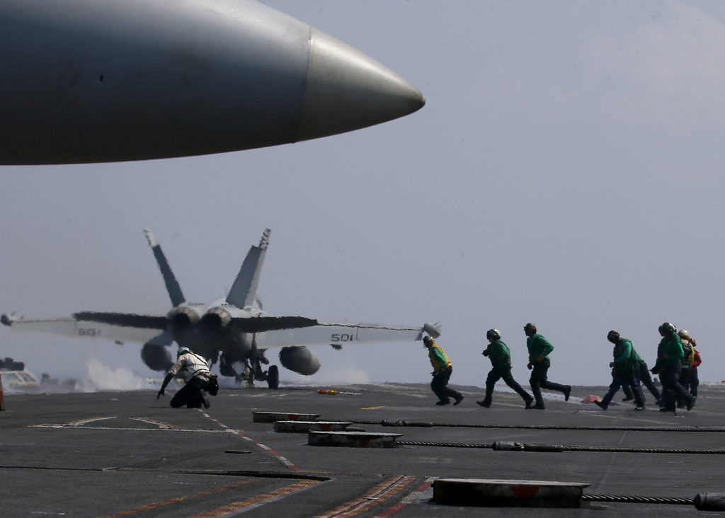 FILE - In this March 3, 2017 file photo, a U.S. Navy F-18 fighter jet takes off from the deck of the USS Carl Vinson (CVN 70) aircraft ...