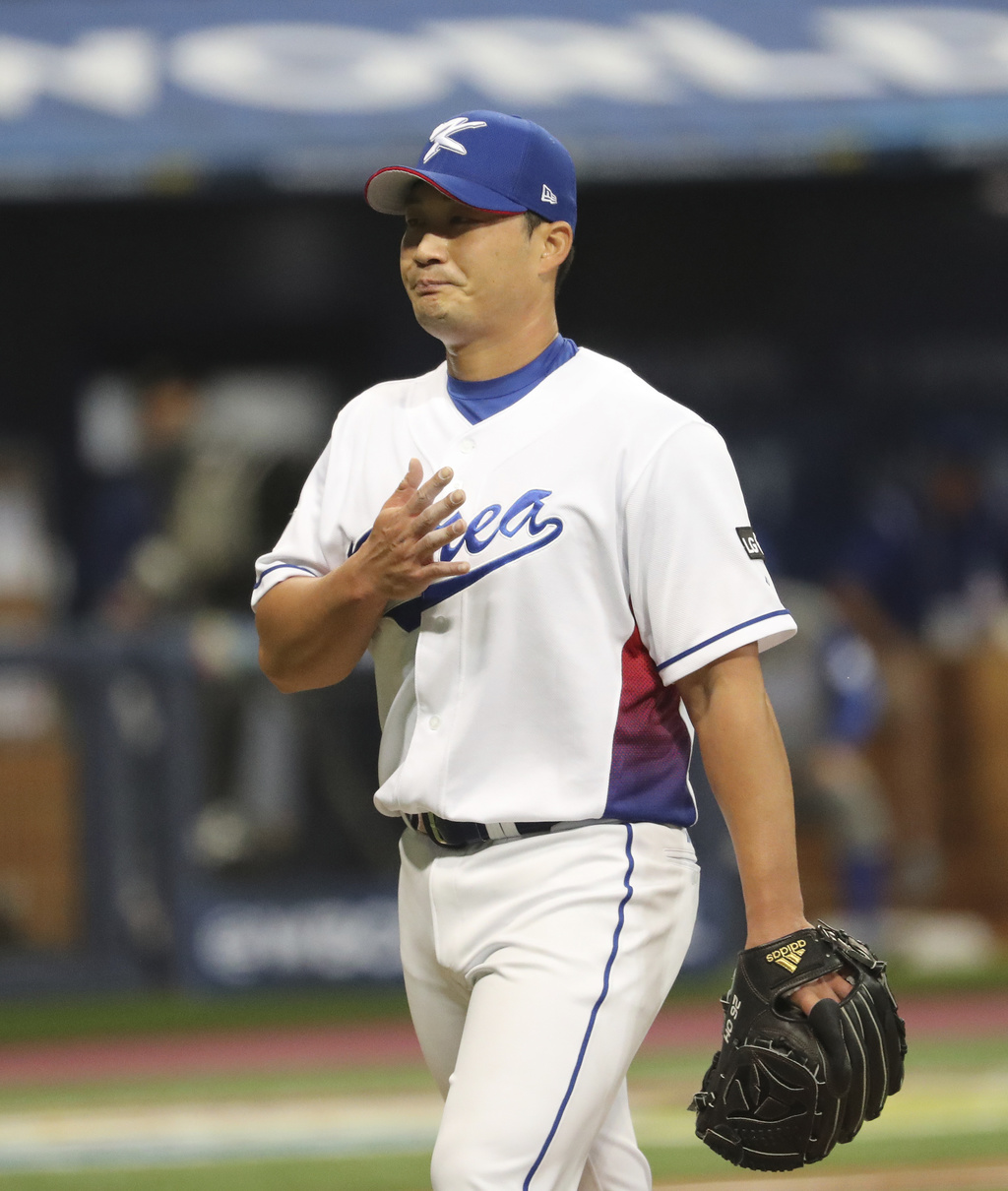 South Korea's pitcher Seung Hwan Oh walks to the dugout during the game against Israel at the first round game of the World Baseball Cl...