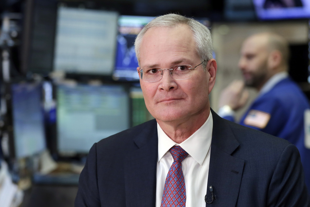 In this Wednesday, March 1, 2017, photo, Exxon Mobil Chairman & CEO Darren Woods sits for an interview on the floor of the New York Sto...