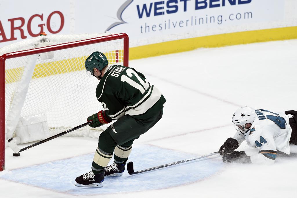 Minnesota Wild center Eric Staal (12) scores an empty net goal against San Jose Sharks defenseman Marc-Edouard Vlasic (44) during the t...