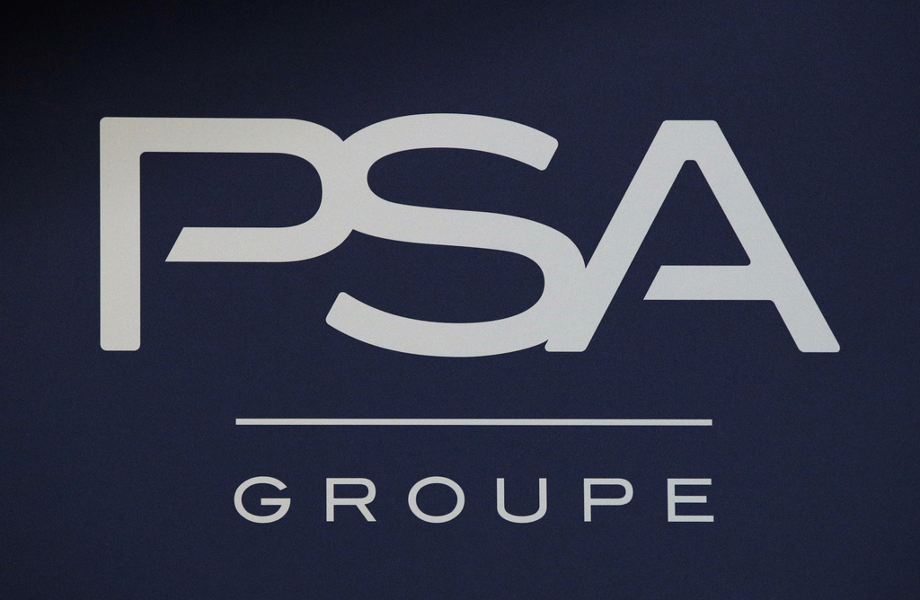 FILE - In this Thursday, Feb. 23, 2017, file photo, the logo of PSA Group is pictured during the presentation of the company's 2016 ful...