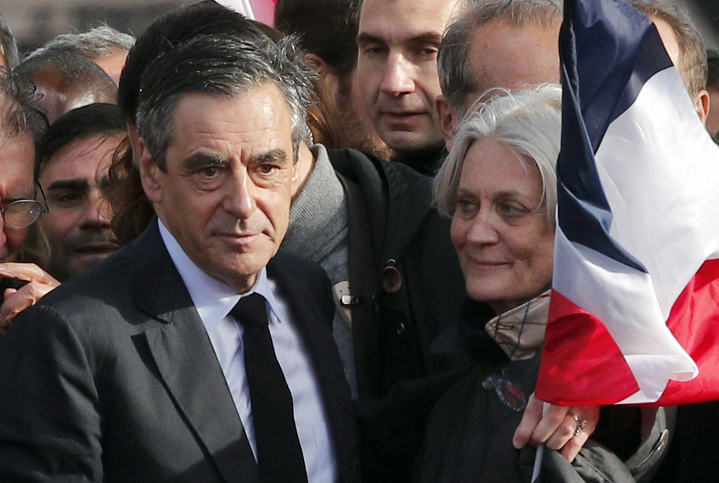 French conservative presidential candidate Francois Fillon and his wife Penelope appear during a rally in Paris, Sunday, March 5, 2017....