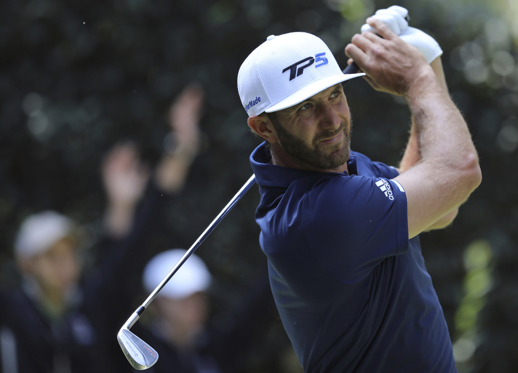 Dustin Johnson, of the United States, tees off on the 5th hole during the final round of the Mexico Championship at Chapultepec Golf Cl...