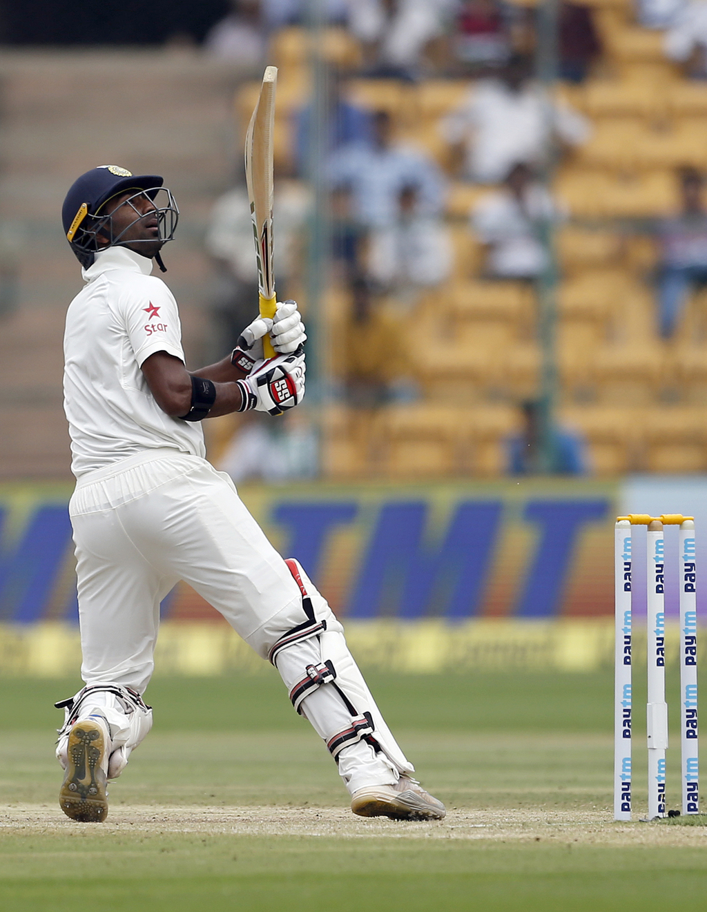 India's Abhinav Mukund watches his shot during the third day of their second test cricket match against Australia in Bangalore, India, ...
