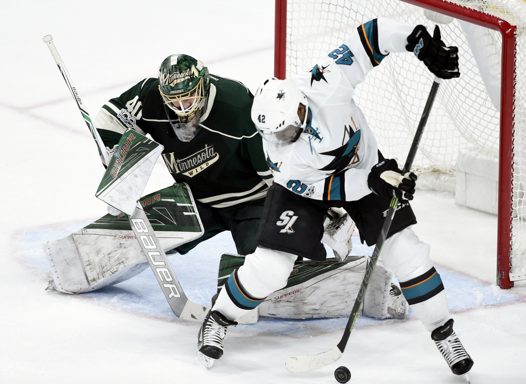 Minnesota Wild goalie Devan Dubnyk (40) blocks a shot by San Jose Sharks right wing Joel Ward (42) during the first period of an NHL ho...