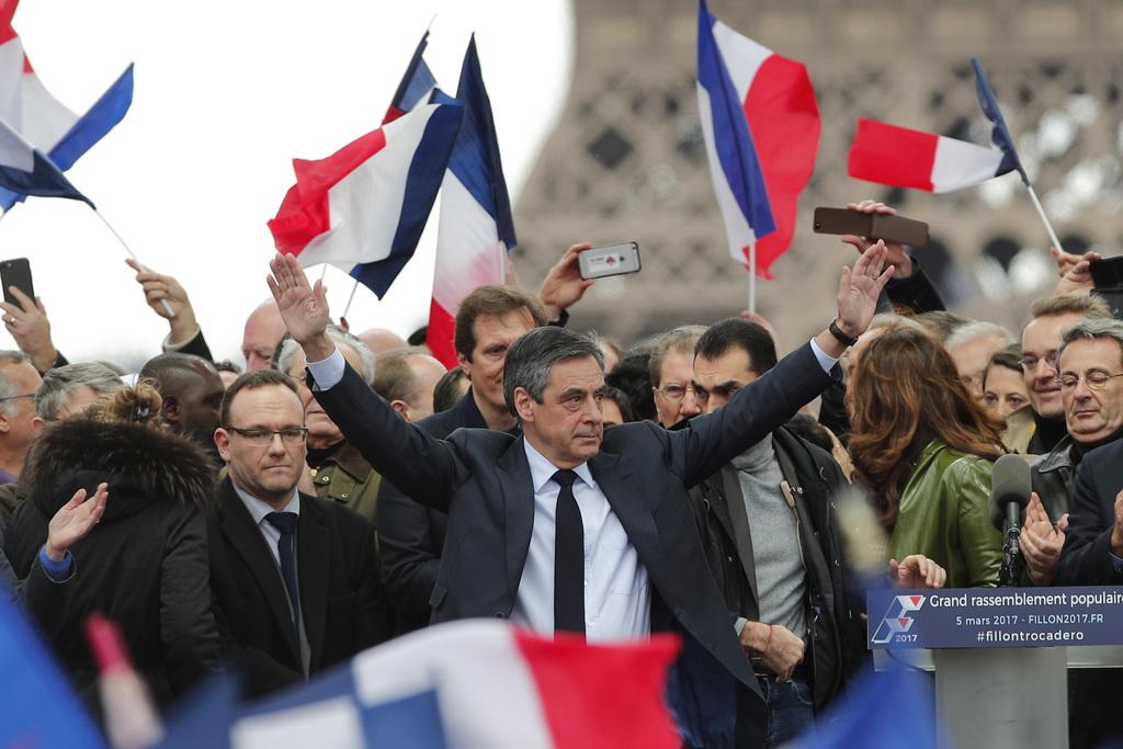 French conservative presidential candidate Francois Fillon cheers the crowd after delivering his speech during a rally in Paris, Sunday...