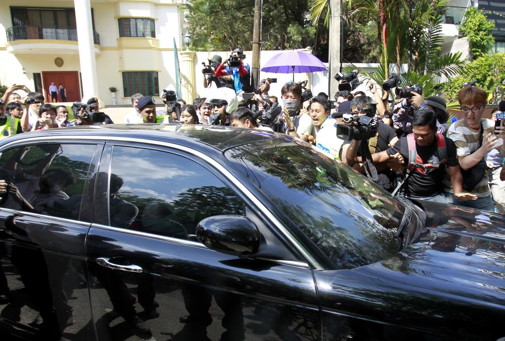 A car carrying North Korean Ambassador to Malaysia Kang Chol passes by journalists gathered outside North Korean Embassy in Kuala Lumpu...