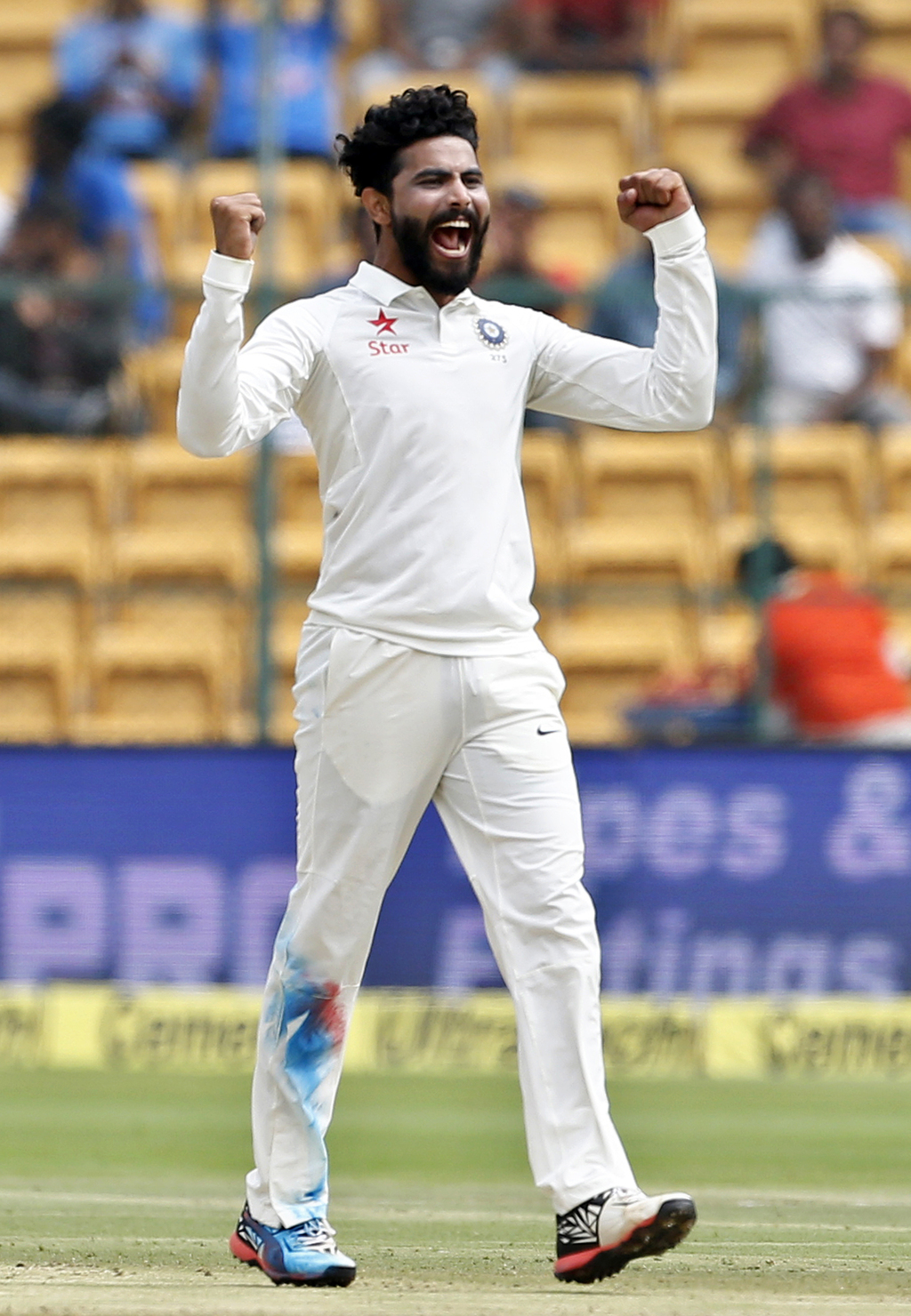 India's Ravindra Jadeja celebrates the dismissal of Australia's Nathan Lyon during the third day of their second test cricket match in ...