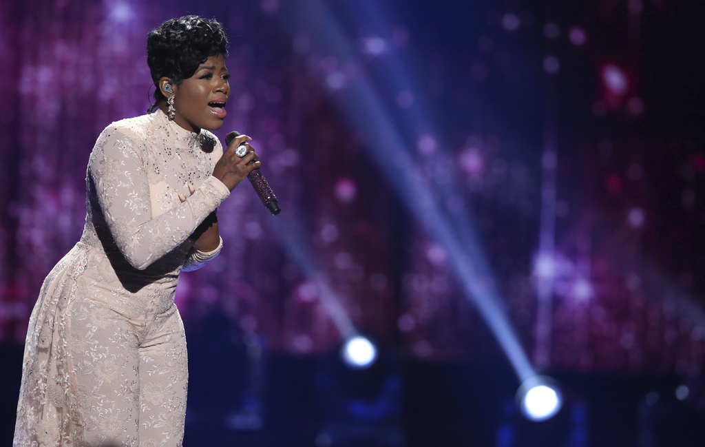 """FILE - In this April 7, 2016, file photo, Fantasia Barrino performs at the """"American Idol"""" farewell season finale at the Dolby Theatre ..."""