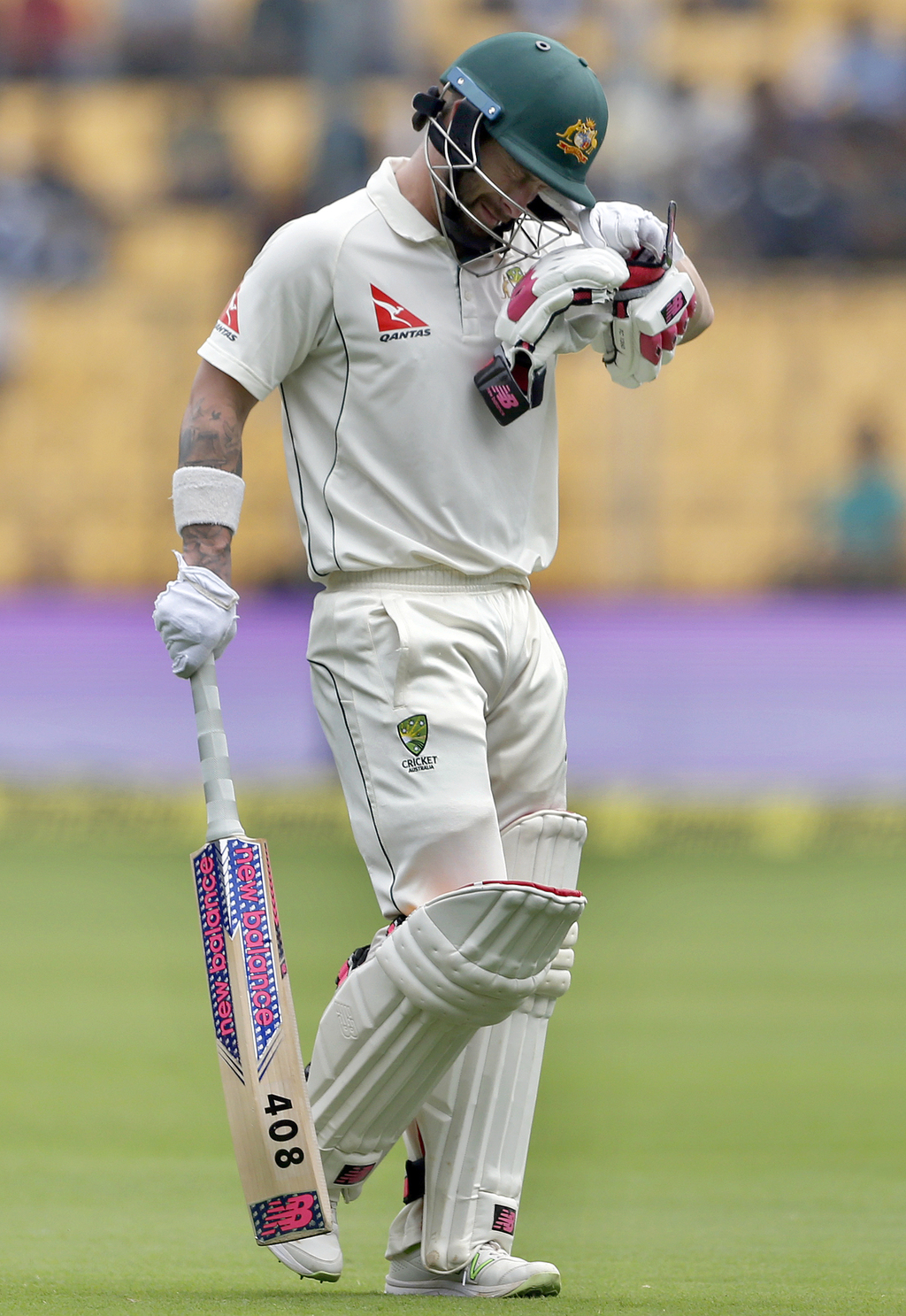 Australia's Matthew Wade leaves the field after being dismissed during the third day of their second test cricket match against India i...