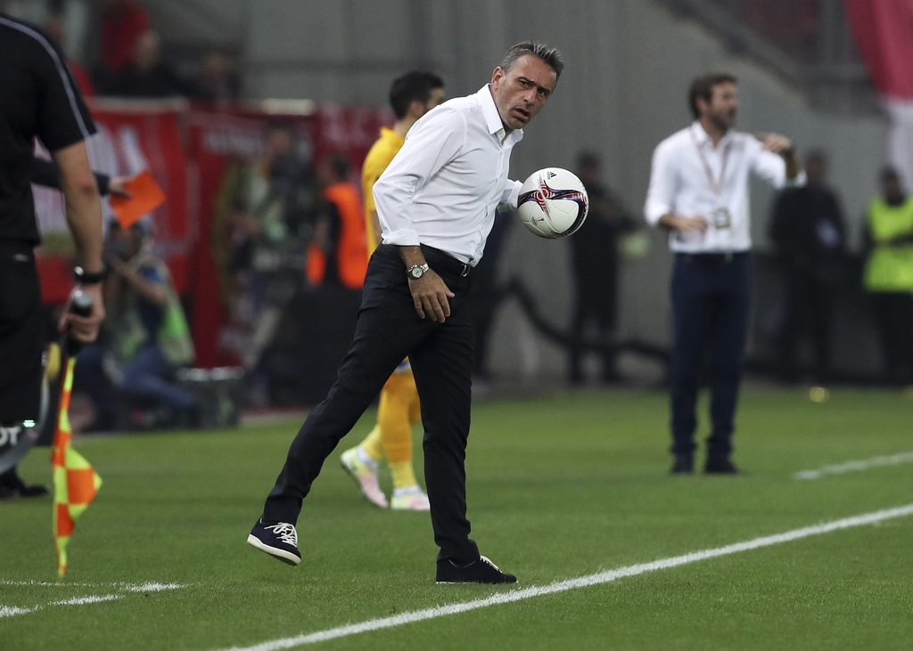 FILE - In this Thursday, Sept. 29, 2016 file photo Olympiakos' coach Paulo Bento holds the ball during the Europa League Group B soccer...