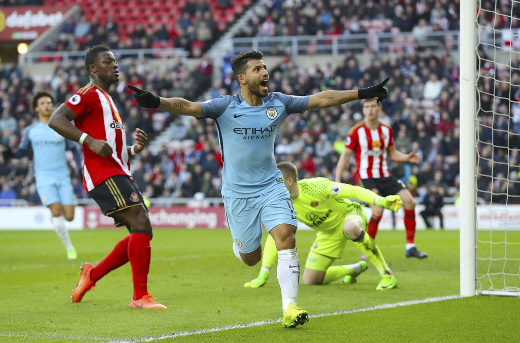 Manchester City's Sergio Aguero celebrates scoring his side's first goal of the game during the Premier League soccer match between Sun...