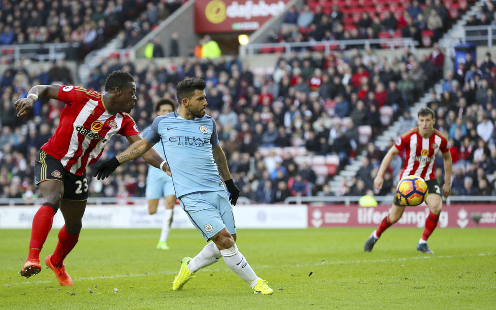 Manchester City's Sergio Aguero scores his side's first goal of the game during the Premier League soccer match between Sunderland and ...