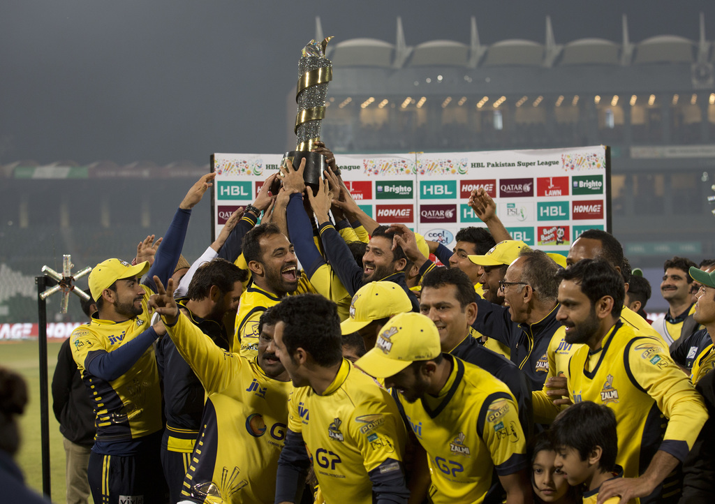 Pakistan's Peshawar Zalmi celebrate their victory in the Pakistan Sports League at Gaddafi stadium in Lahore, Pakistan, Sunday, March 5...