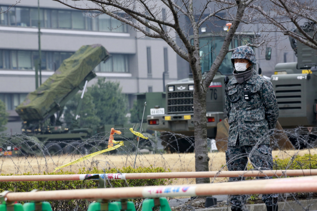A member of Japan Self-Defense Force stands by a PAC-3 Patriot missile unit deployed against the North Korea's missile  firing, at the ...