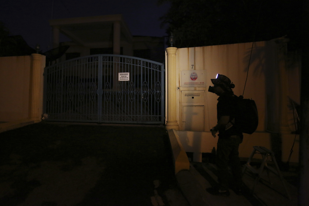 A journalist waits in front of the North Korean embassy in Kuala Lumpur, Malaysia, Monday, March 6, 2017.  Malaysia said Sunday that it...