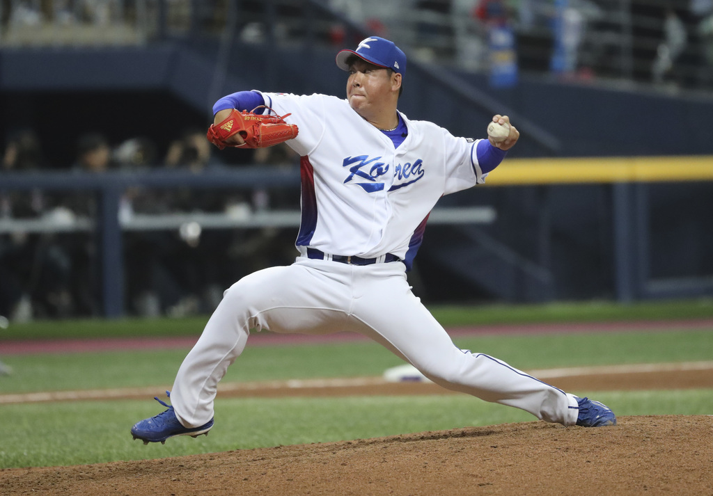 South Korea's Lee Hyun-seung throws against Israel during the seventh inning of the first round game of the World Baseball Classic at G...