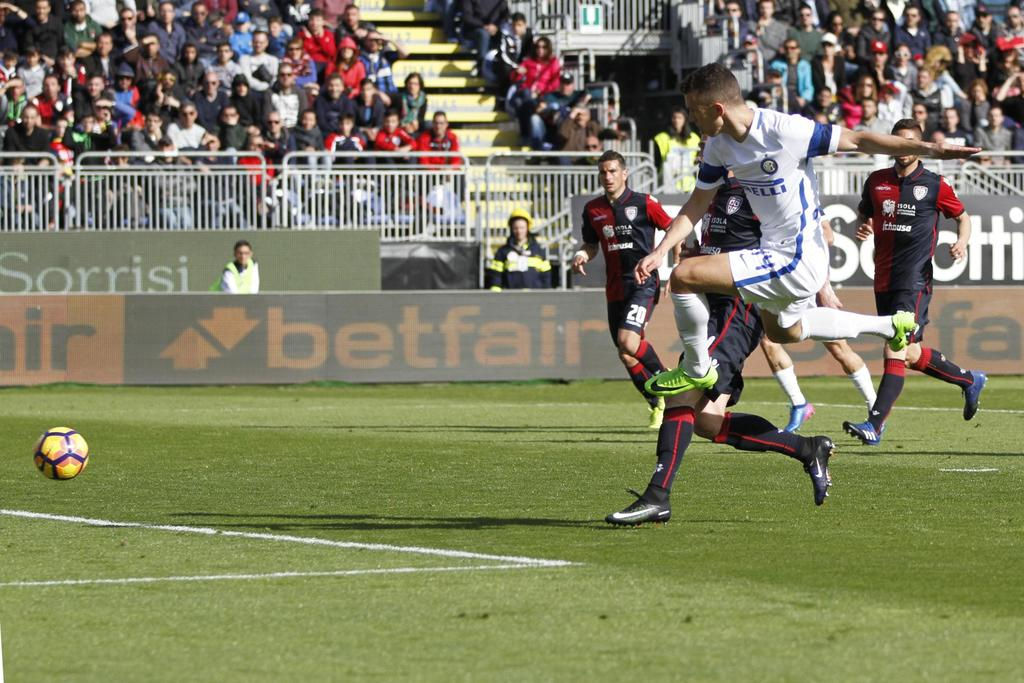 Inter Milan's Ivan Perisic scores during a Serie A soccer match between Inter Milan and Cagliari, at the Sant'Elia stadium in Cagliari,...