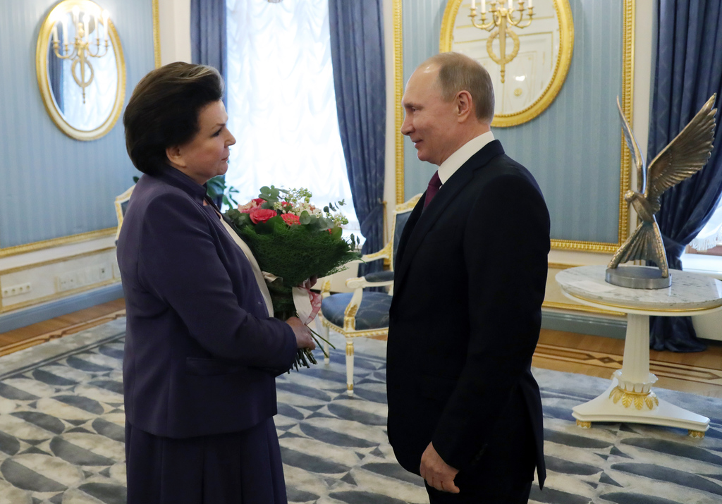 Russian President Vladimir Putin, right, congratulates the first woman in space, cosmonaut Valentina Tereshkova, on her 80th birthday i...