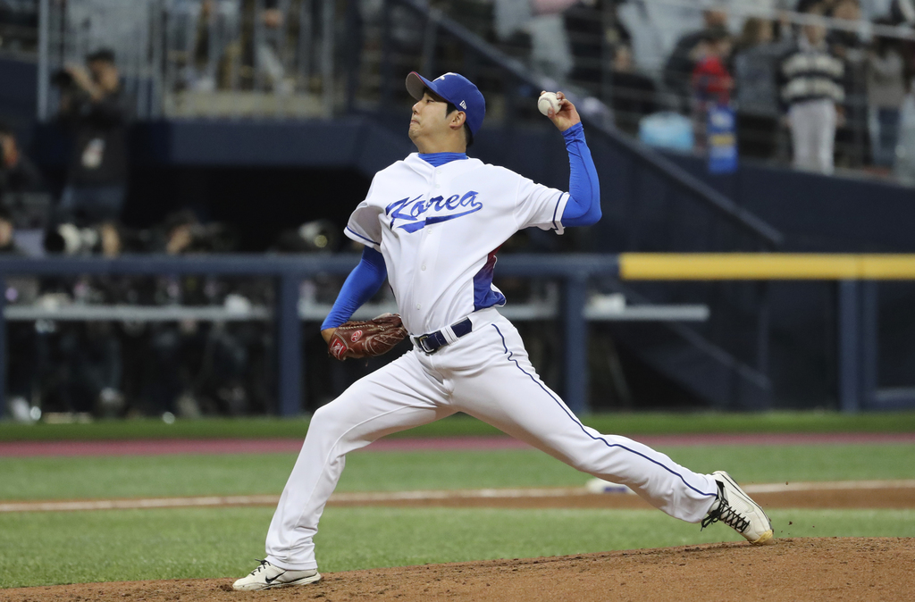 South Korea's starting pitcher Chang Won-jun throws against Israel during the third inning of their first round game of the World Baseb...