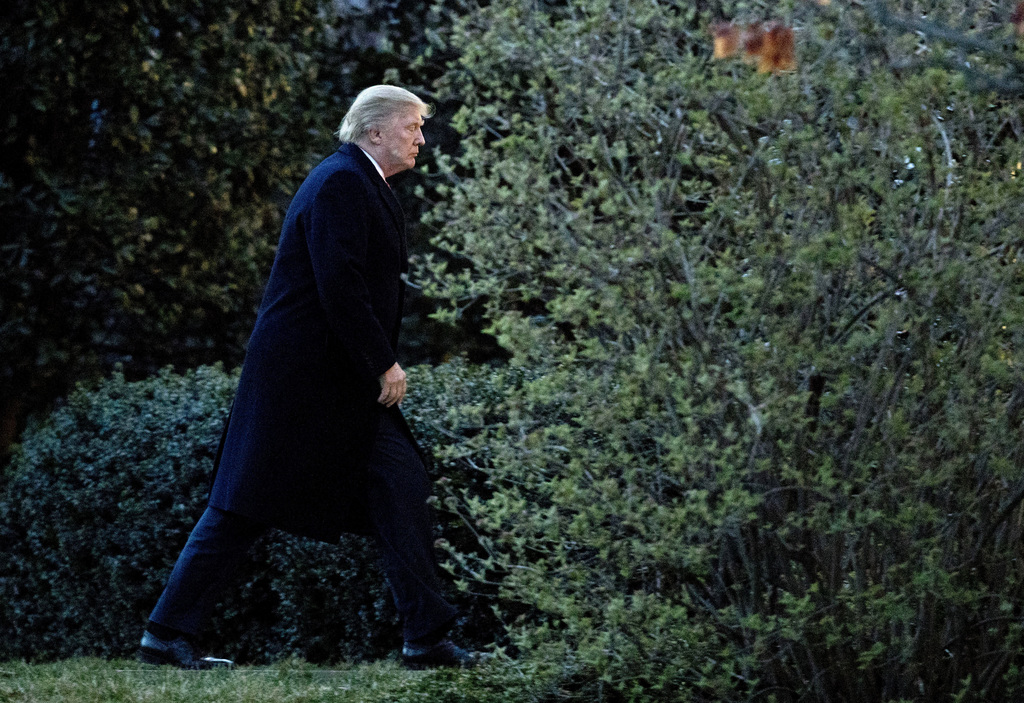 President Donald Trump walks to the Oval Office upon arrival at the White House in Washington, Sunday, March 5, 2017, from a trip to Fl...