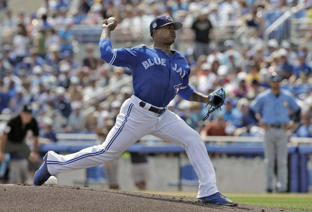 Toronto Blue Jays starting pitcher Marcus Stroman delivers to the Tampa Bay Rays during the first inning of a spring training baseball ...