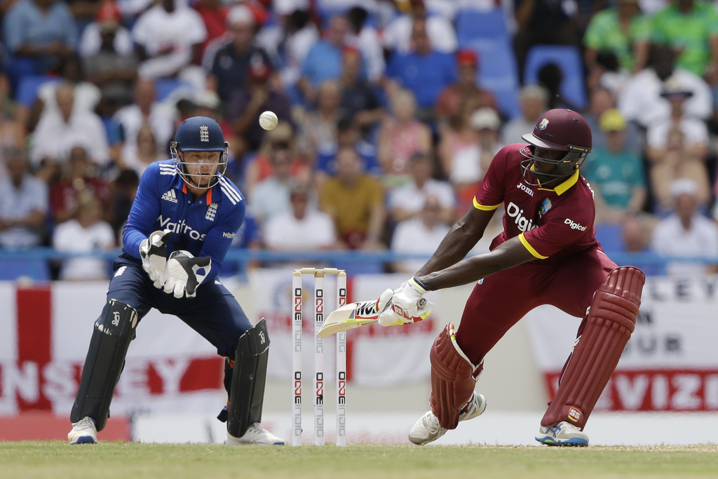 West Indies' captain Jason Holder plays a shot from the bowling of England's Adil Rashid during their second one day international cric...