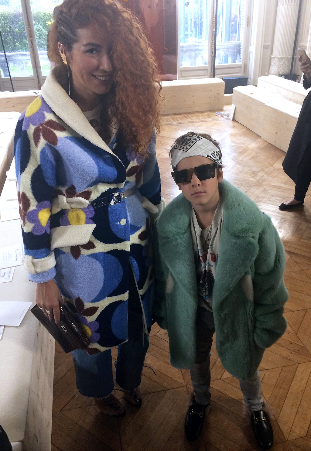 Fashion designer Natasha Zinko poses with her son Ivan, 9, one of the world's youngest fashion designers, before Valentino's fall-winte...