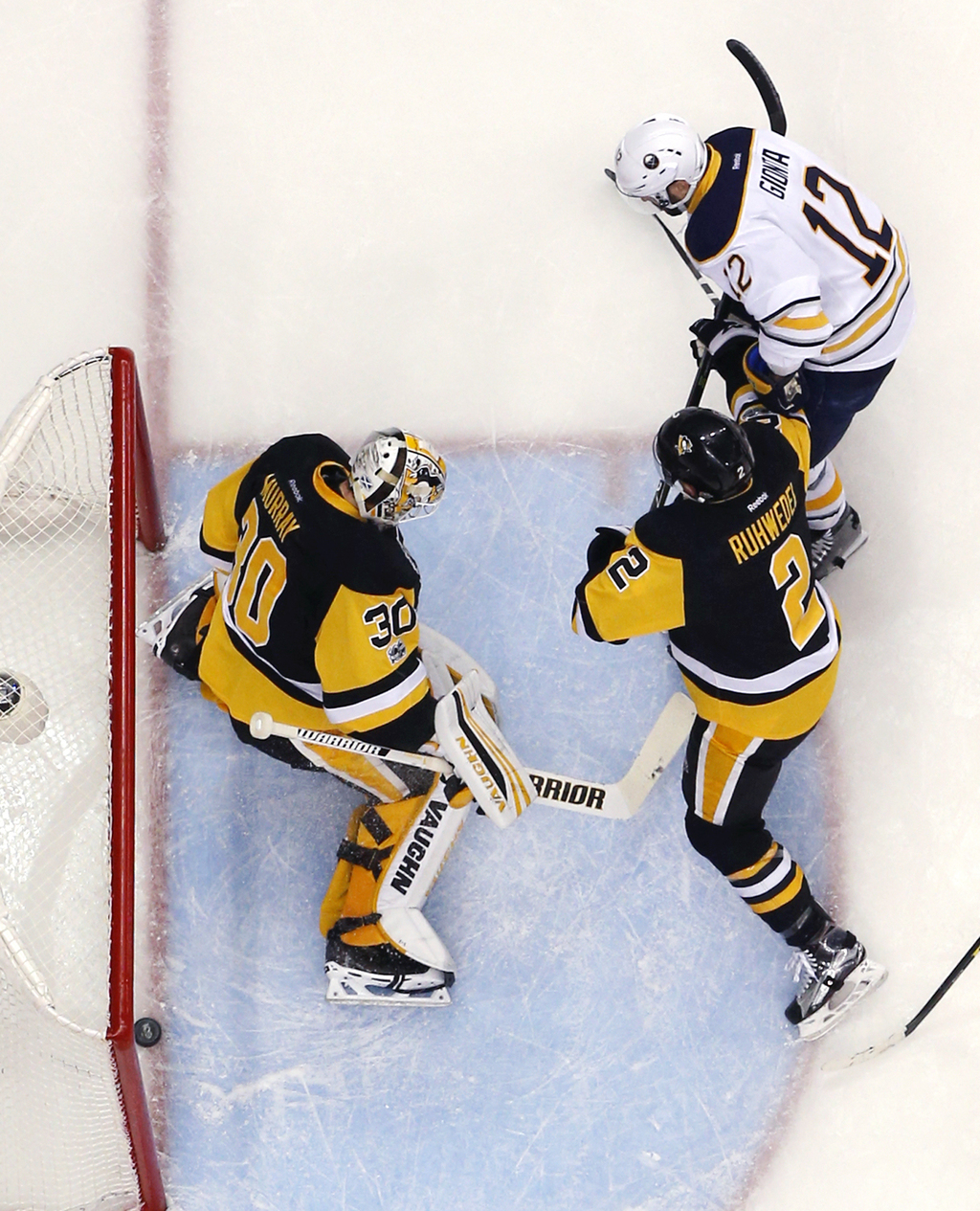 Buffalo Sabres' Brian Gionta (12) gets a rebound behind Pittsburgh Penguins goalie Matt Murray (30) for a goal with Chad Ruhwedel (2) d...