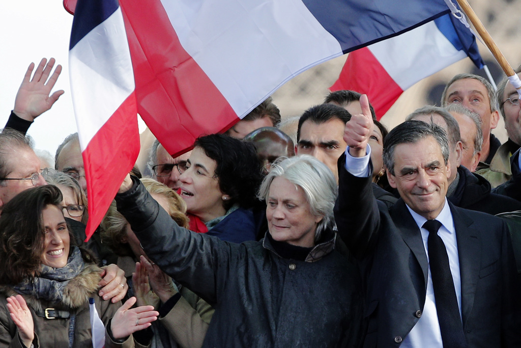 French conservative presidential candidate Francois Fillon, right, thumbs up with his wife Penelope after delivering his speech during ...
