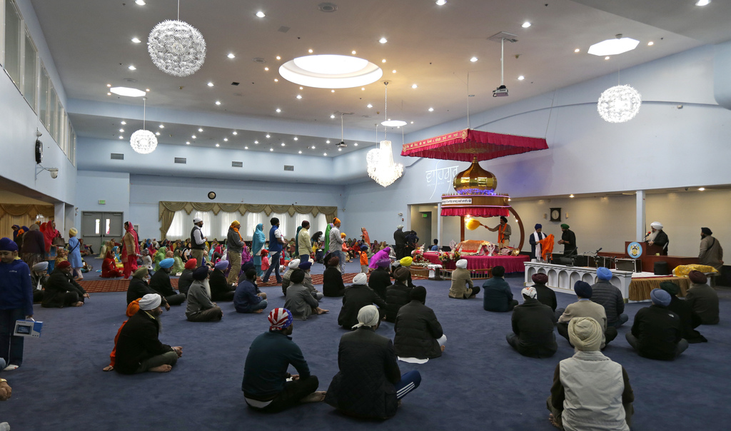 Men and women attend Sunday services at the Gurudwara Singh Sabha of Washington, a Sikh temple in Renton, Wash., Sunday, March 5, 2017,...