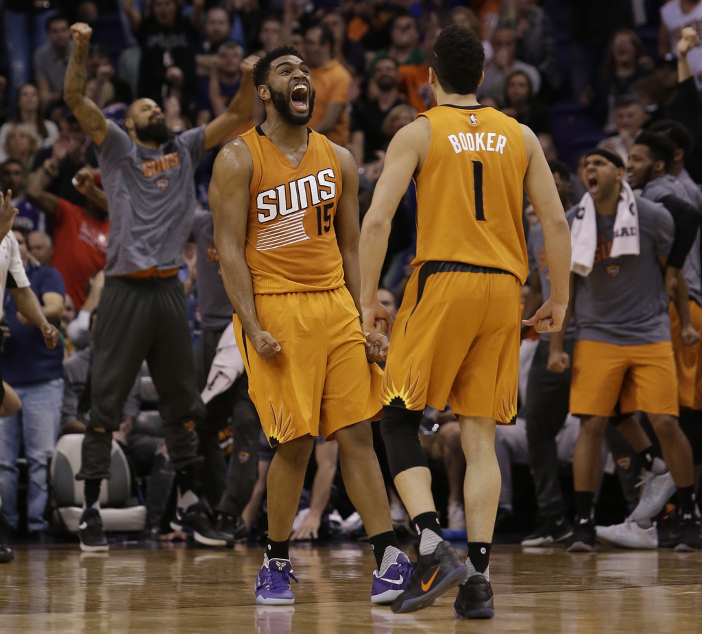 Phoenix Suns forward Alan Williams (15) celebrates with Devin Booker during an NBA basketball game against the Boston Celtics, Sunday, ...