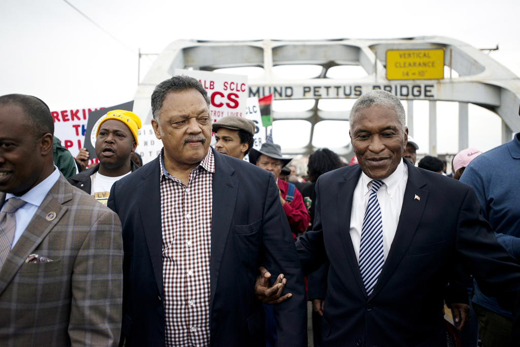The Rev. Jesse Jackson, left, walks with Tuskegee Mayor Johnny Ford during the annual re-enactment of a key event in the civil rights m...