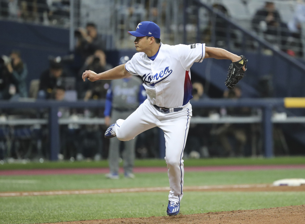 South Korea's pitcher Seung Hwan Oh throws against Israel during the ninth inning of the first round game of the World Baseball Classic...