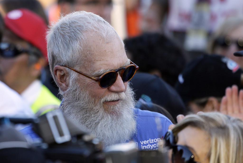 FILE - In this Sept. 18, 2016, file photo, David Letterman stands near victory lane and watches celebrations after the IndyCar auto rac...