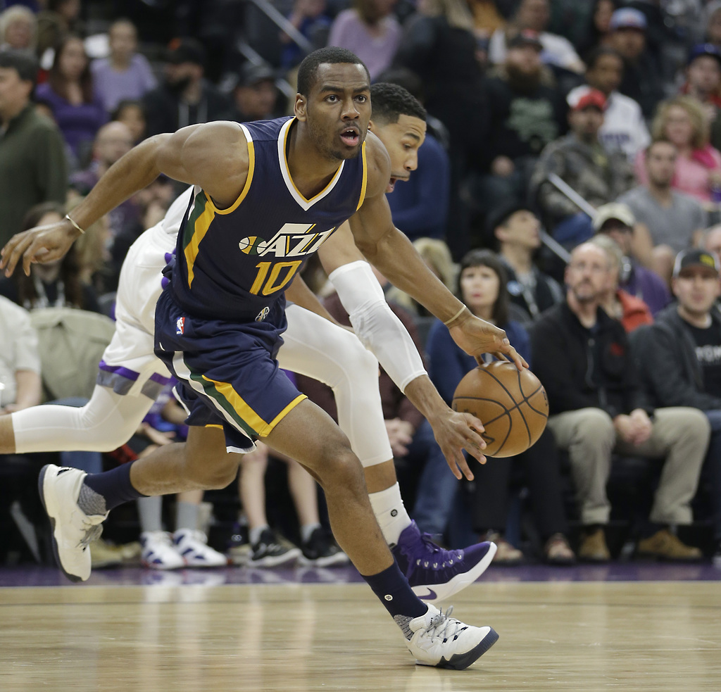 Utah Jazz guard Alec Burks, left, has the ball stolen from him by Sacramento Kings guard Garrett Temple, right, during the first half o...