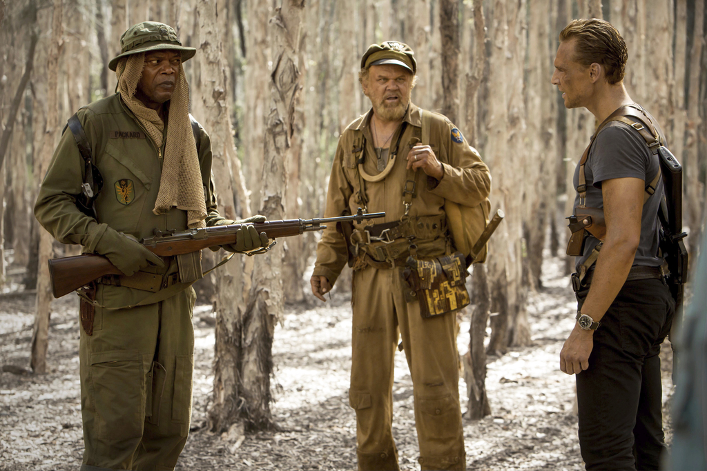 In this image released by Warner Bros. Pictures, Samuel L. Jackson, from left,  John C. Reilly and Tom Hiddleston appear in a scene fro...