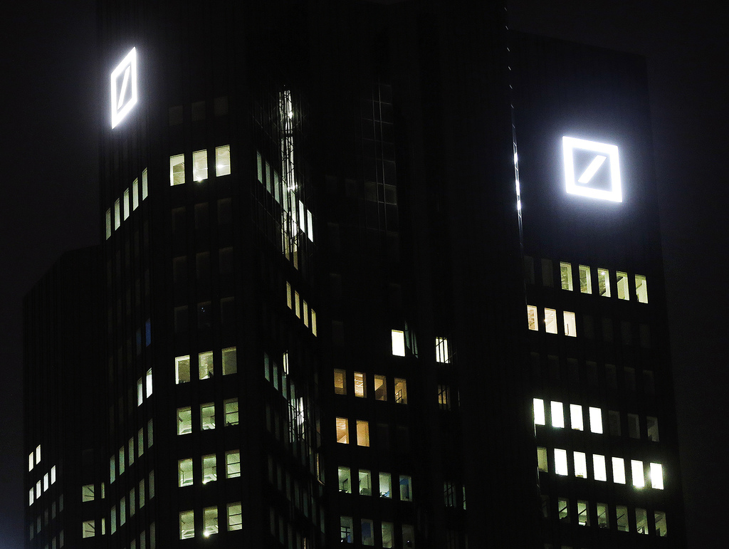 FILE - In this Sept. 30, 2016 file photo, the bank's logos are pictured at the headquarters of Deutsche Bank in Frankfurt, Germany. Deu...