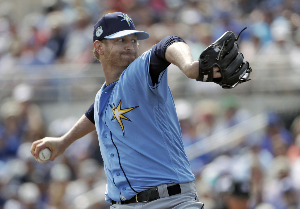 Tampa Bay Rays starting pitcher Alex Cobb delivers to the Toronto Blue Jays during the first inning of a spring training baseball game ...