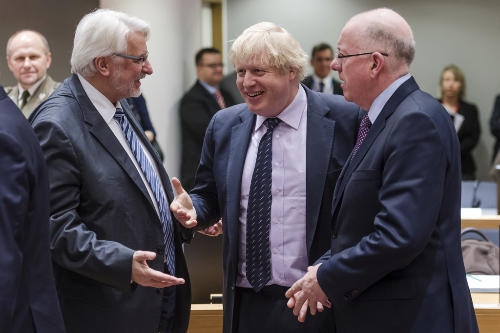 Britain's Foreign Secretary Boris Johnson, center, talks with Poland's Foreign Minister Withold Waszczykowski, left, and Ireland's Fore...