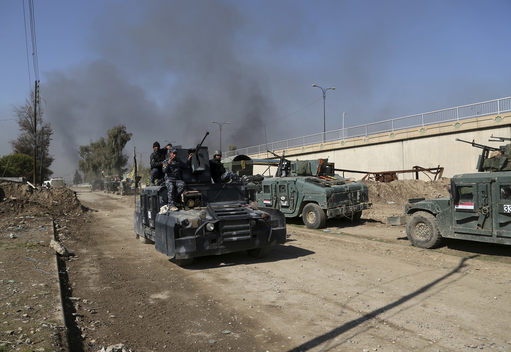 Iraqi security forces advance during fighting against Islamic State militants, in western Mosul, Iraq, Monday, March 6, 2017.  Iraqi go...