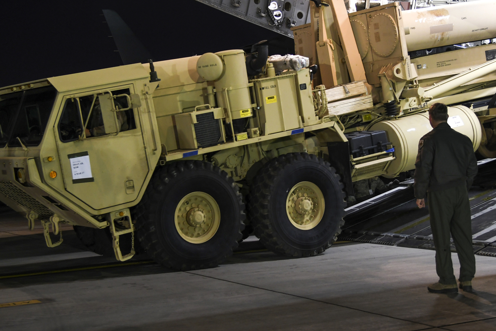 In this photo provided by U.S. Forces Korea, a truck carrying parts of U.S. missile launchers and other equipment needed to set up the ...