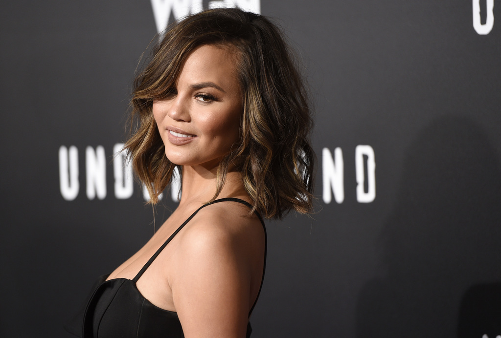 """FILE - In this Feb. 28, 2017, file photo, model Chrissy Teigen poses at the season two premiere of the television series """"Underground"""" ..."""