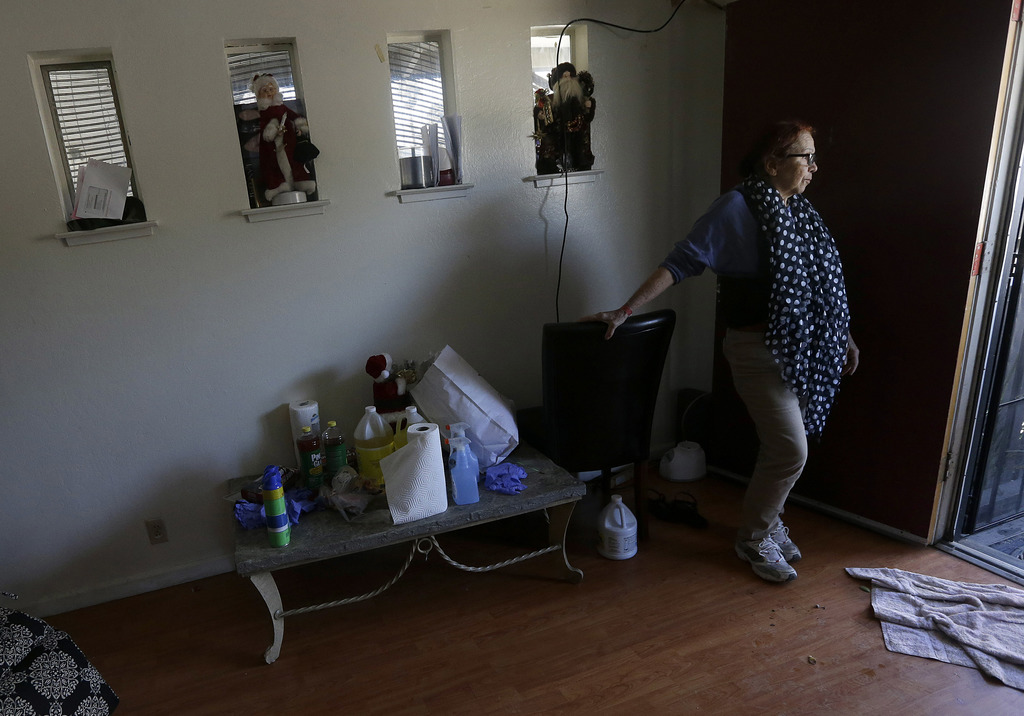 In this March 1, 2017 photo, Cruz Antonia is interviewed in the home she has been displaced from due to flood damage in San Jose, Calif...