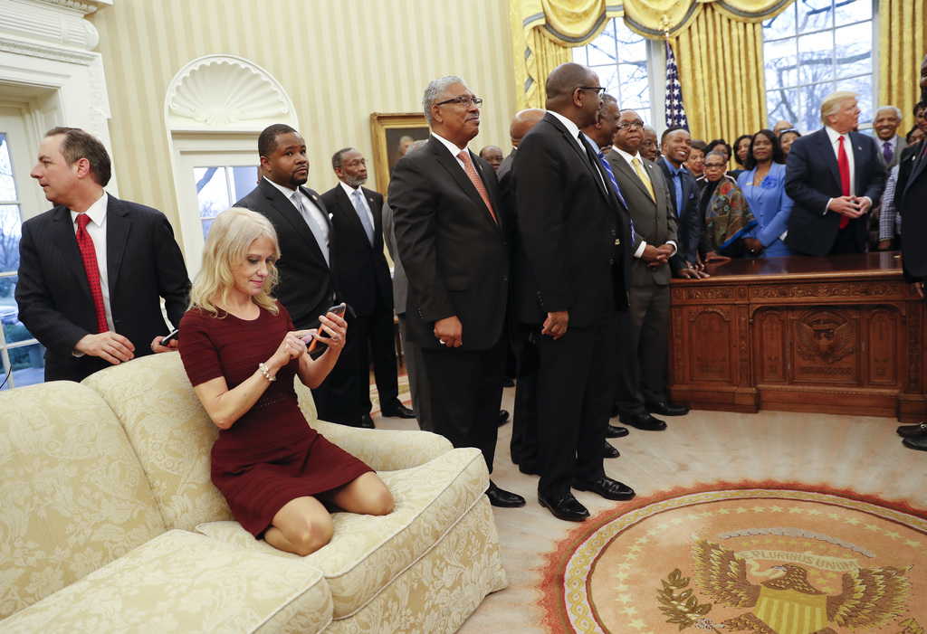 In this photo taken Feb. 27, 2017, Counselor to the President Kellyanne Conway, on couch, as President Donald Trump meets with leaders ...